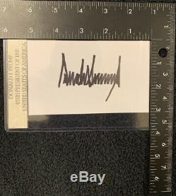 President Donald Trump signed 3x5 index card